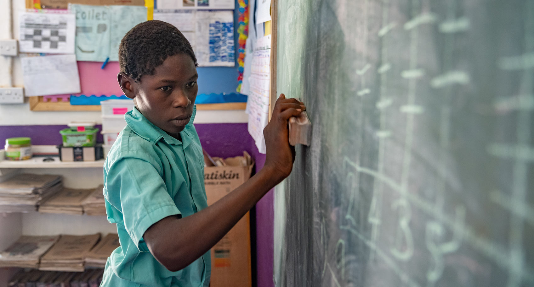 Photo of boy at blackboard in Zimbabwe